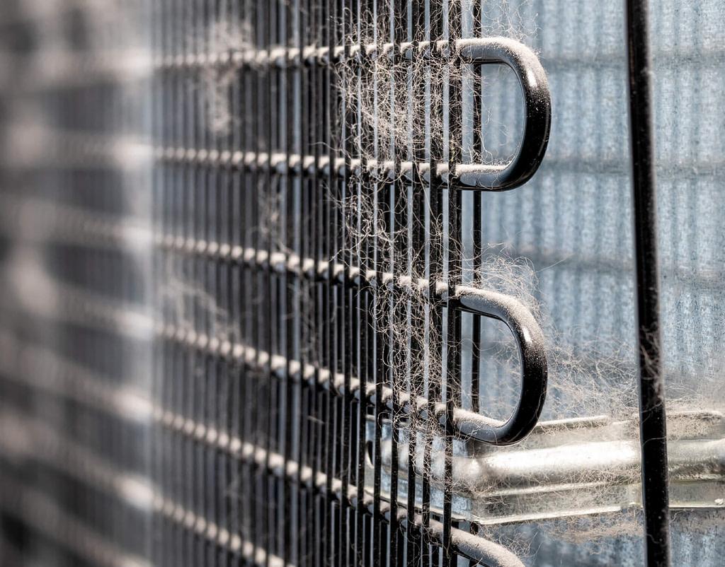 dirty and dusty fridge freezer coils