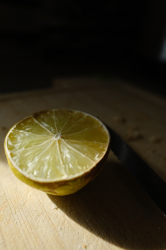 open half of a cut lime on a table