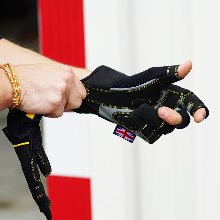 Rigger putting on a Dirty Rigger work glove to show the glove fit