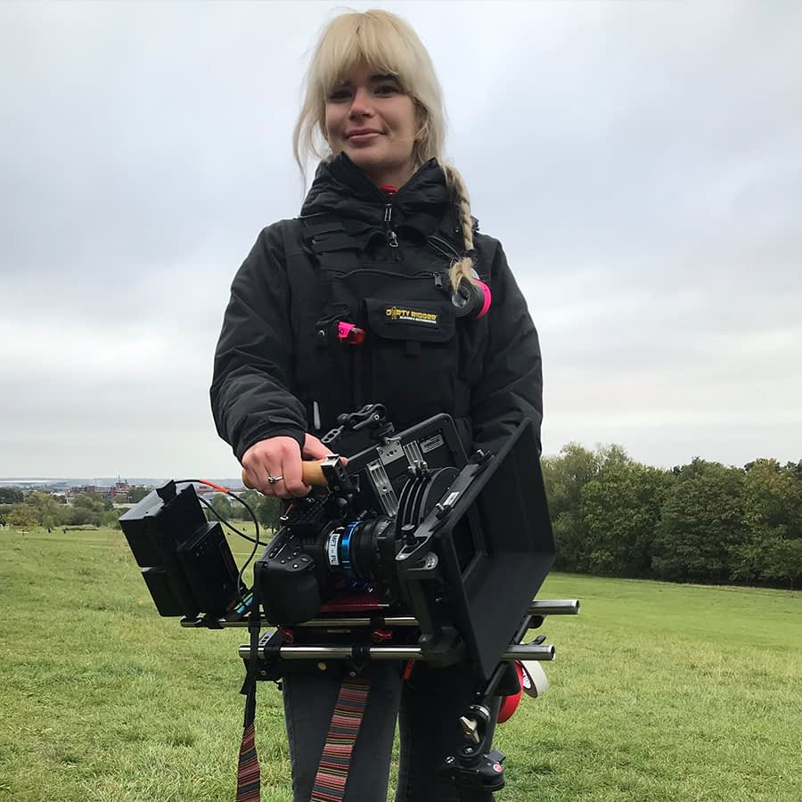 Camera assistant Bianka wearing our LED Chest Rig whilst holding a camera on set