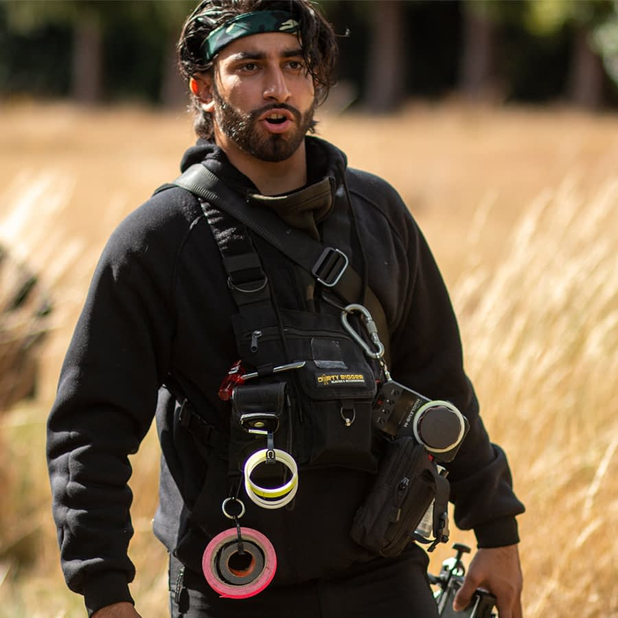 Riaz wearing our LED Chest Rig on a film set with gaffer tape attachments