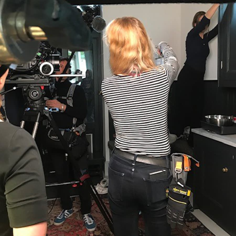 Camera assistant Bianka on set with a gaffer tape attachment and Dirty Rigger comfort fit gloves
