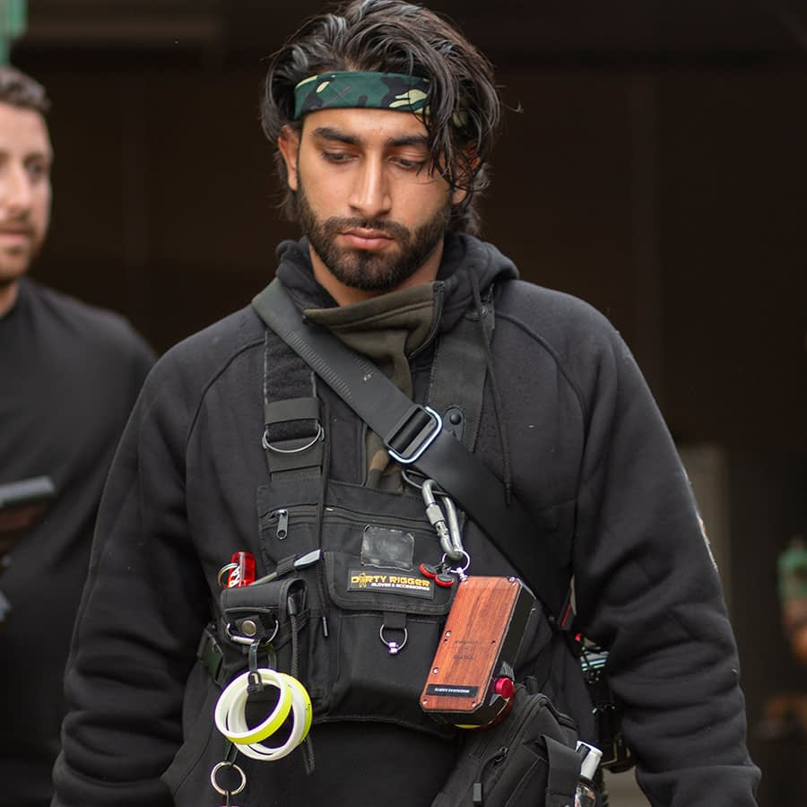 Riaz wearing our LED Chest Rig on a film set with gaffer tape attachments and light metre