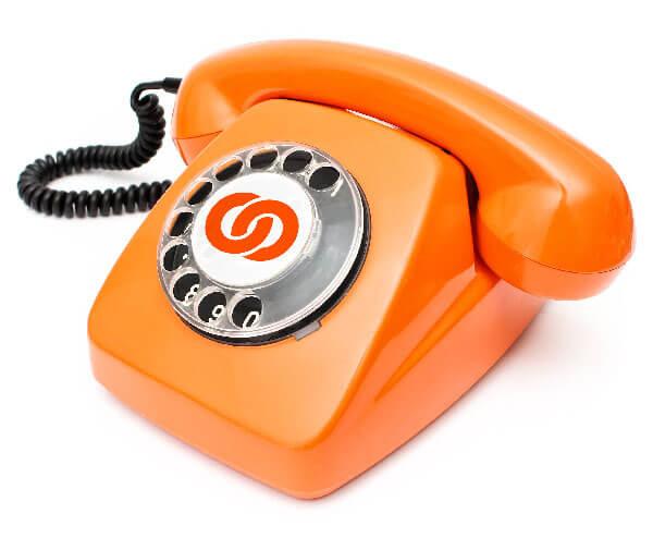 An old-fashioned orange telephone