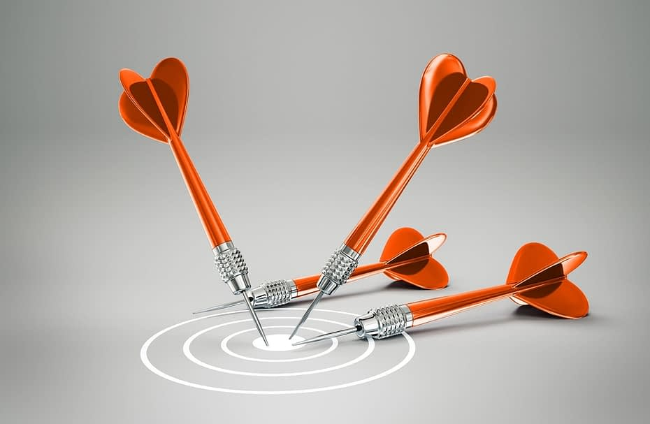 conceptual darts isolated on a grey background