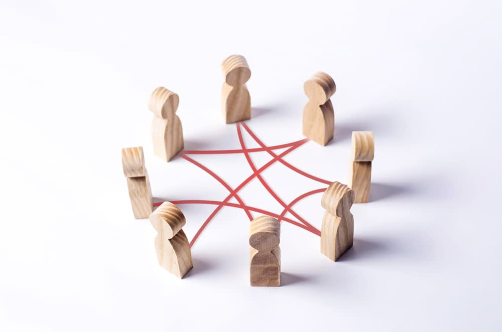 Wooden figures in a network