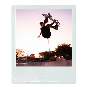A polaroid photo of a boy skateboarding