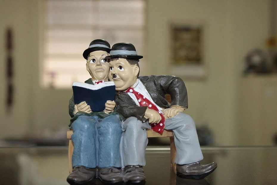 Laurel and hardy model reading a book