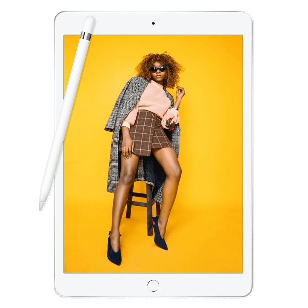iPad and pencil showing stylish woman sat on a stool