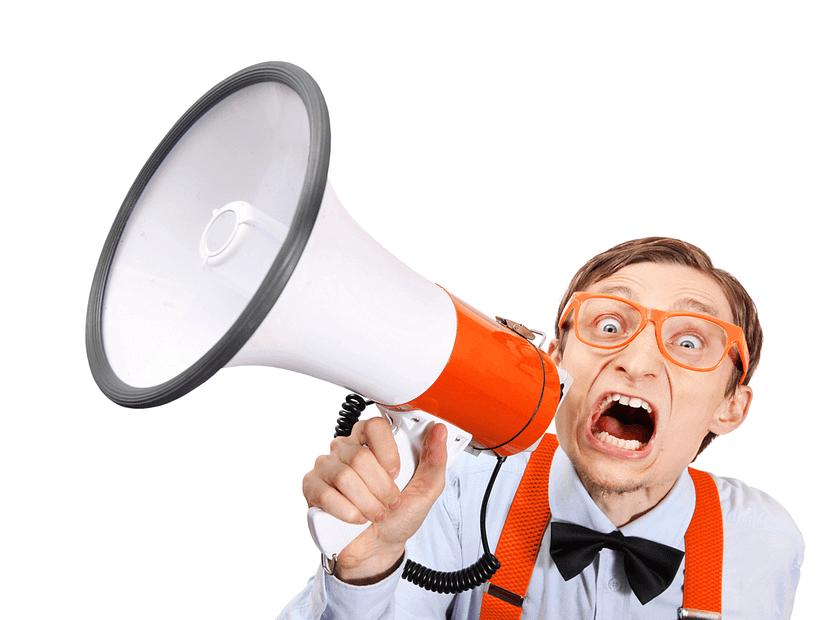 Man on megaphone shouting
