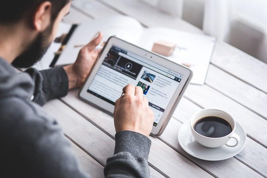 Man reading article on an ipad