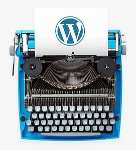 A blue typewriter showing the WordPress logo