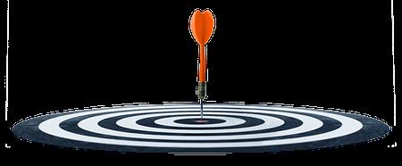 A dart hitting bullseye on target