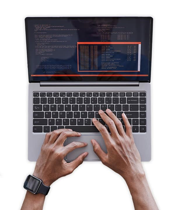 A developer typing code on a laptop